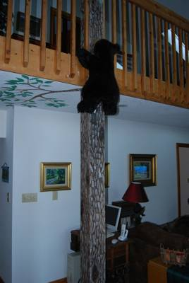 Cabin Art - A bear climbing a tree